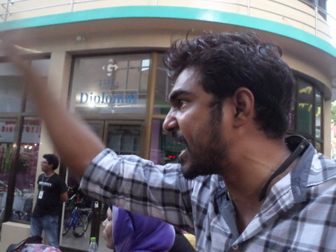 Where is my vote? An angry protester confronts security forces at a protest in Male' yesterday demanding early elections