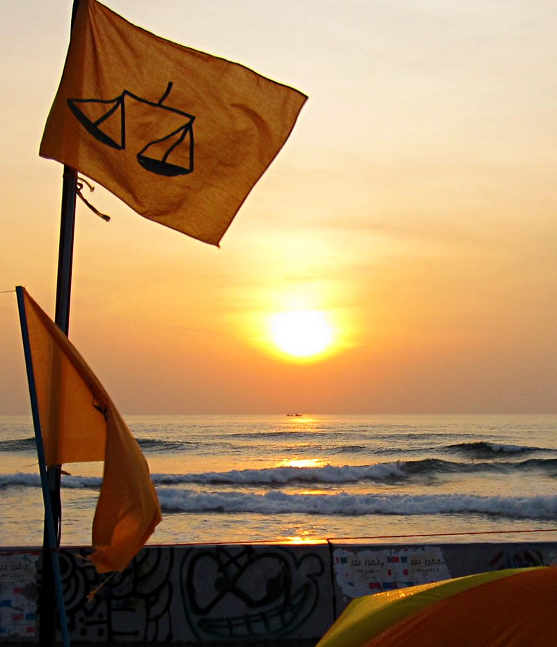 The scales of justice adorn the MDP flag at dawn in the MDP demonstration area on the eastern edge of Malé. Photo: maldivesculture.com