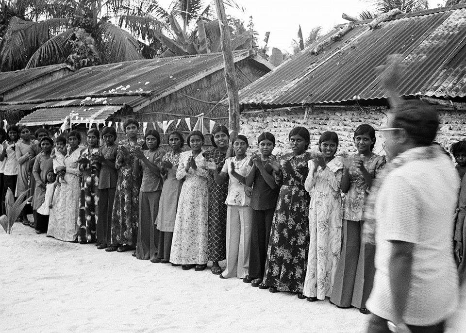 Maldivian women lining up to greet Gayoom visiting their island during the early days of his presidency. Photo: Images of Maldives Past